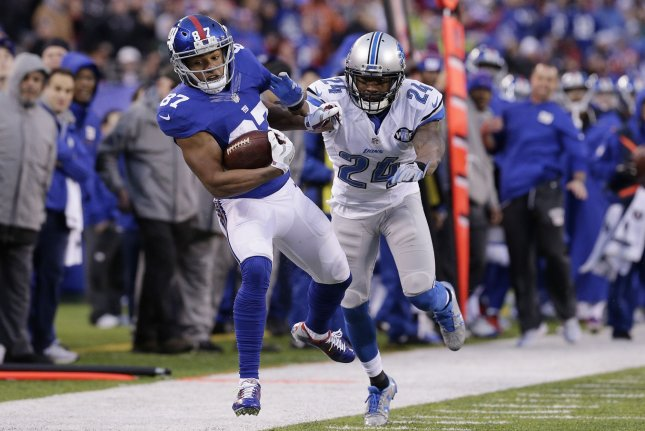 Detroit Lions' Nevin Lawson chases New York Giants receiver Sterling Shepard, who runs for a gain of 23 yards in week 15 of the NFL season at MetLife Stadium in East Rutherford, New Jersey on December 18, 2016. File photo by John Angelillo/UPI