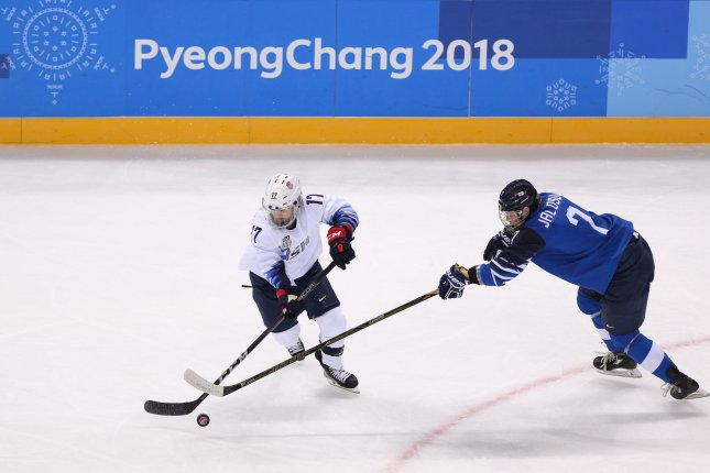 United States of America  hockey's Lamoureux-Davidson nets two, breaks Olympic record