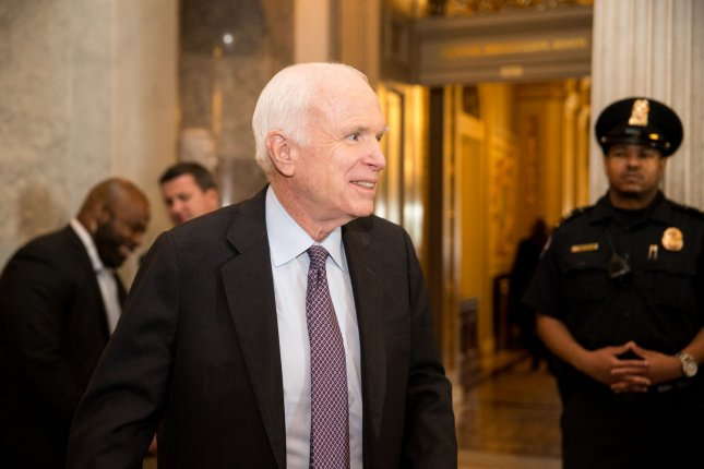 Sen. John McCain, R-Ariz., leaves the Senate floor during debate on healthcare reform and repeal on Capitol Hill in Washington, D.C., last year. File Photo by Erin Schaff/UPI