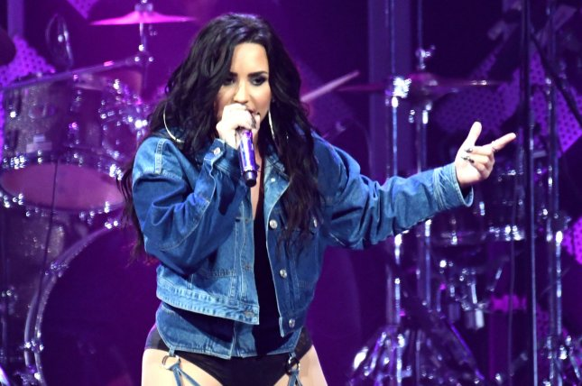 Demi Lovato won't head to South America as planned since she is focusing on her sobriety following a July drug overdose. File Photo by Gary I Rothstein/UPI