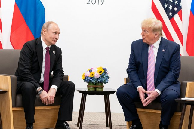 President Donald Trump (R) sits across from Russian President Vladimir Putin at the G20 Japan Summit on June 28, 2019, in Osaka, Japan. This year's summit will be mostly virtual because of the pandemic. Photo by Shealah Craighead/UPI