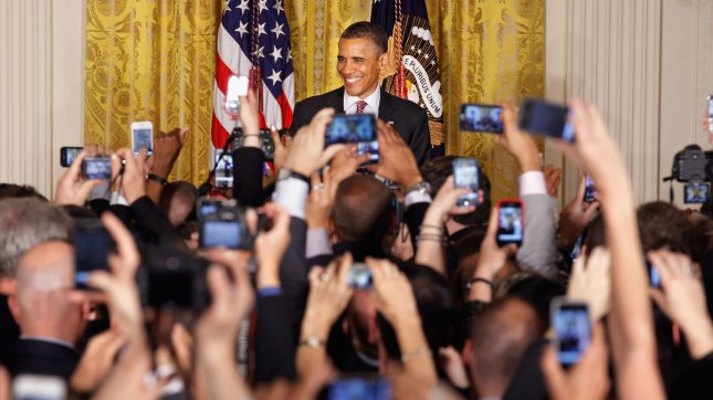 A sea of cell phones snap pictures as U.S. President Barack Obama hosts a reception in honor of national Gay, Lesbian, Bisexual and Transgender Pride Month in the East Room of the White House June 15, 2012 in Washington, DC. In the midst of a re-election campaign against former Massachusetts Gov. Mitt Romney, Obama's recent declaration of support for same-sex marriage was celebrated as a key endorsement among gay rights groups. UPI/Chip Somodevilla/Pool