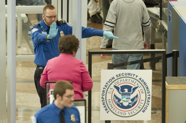 Transportation Security Administration (TSA) agents steer passengers through the security stations. (File/UPI/Gary C. Caskey)