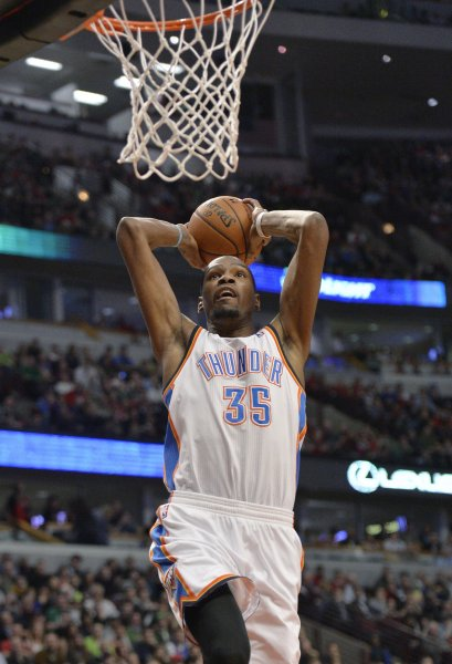 Oklahoma City Thunder forward Kevin Durant dunks during the third quarter against the Chicago Bulls at the United Center in Chicago on March 17, 2014. The Thunder defeated the Bulls 97-85. UPI/Brian Kersey