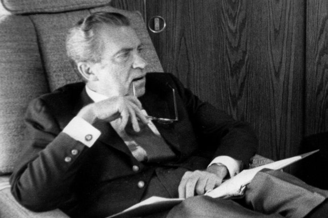 President Richard Nixon is pictured aboard Air Force One en route to Brussels on June 26, 1974. On July 30, 974, the House Judiciary Committee approved a third article of impeachment against President Richard Nixon. Nixon resigned -- just over a week later -- before he could be impeached. UPI File Photo