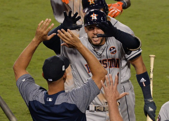 George Springer and the Houston Astros celebrate Springer's game-winning two-run homer against the Los Angeles Dodgersin the 11th inning in Game 2 of the World Series on Wednesday. Photo by Jim Ruymen/UPI