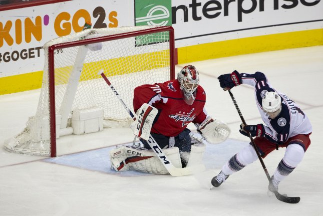 Columbus Blue Jackets left wing Matt Calvert (11) shoots on Washington Capitals goaltender Braden Holtby (70) during the first round NHL playoff game Saturday at Capital One Arena in Washington, D.C. Photo by Alex Edelman/UPI