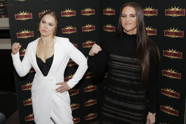 WWE Superstar Ronda Rousey (L) with WWE chief brand officer Stephanie McMahon on March 16. WWE's Smackdown Live will be arriving on Fox on Oct. 9, 2019. File Photo by John Angelillo/UPI