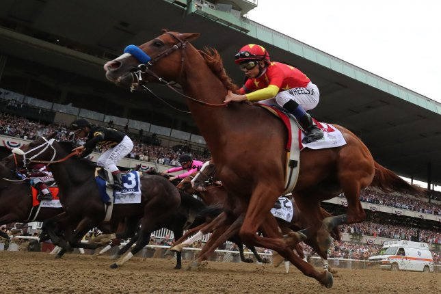 Jockey Mike Smith, aboard Justify, passes the stands on his way to winning the Triple Crown and the 150th Belmont Stakes in Elmont, N.Y., on June 9. Justify became the 13th Triple Crown winner in history. File Photo by Mark Abraham/UPI
