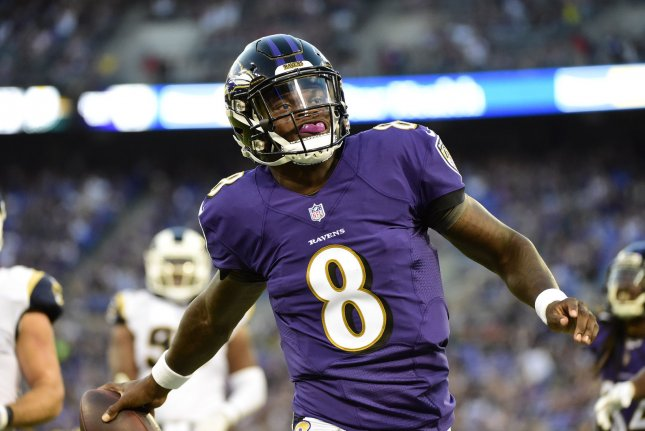 Baltimore Ravens quarterback Lamar Jackson (8) scores a touchdown against the Los Angeles Rams on a 9-yard run during the first half of a preseason NFL game on Thursday at M&T Bank Stadium in Baltimore. Photo by David Tulis/UPI