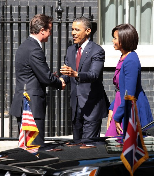 British Prime Minister David Cameron greets US President Barack Obama and his wife the First Lady Michelle Obama at No.10 Downing St during a three day state visit to the United Kingdom in London on Tuesday May 24 2011. UPI/Hugo Philpott.