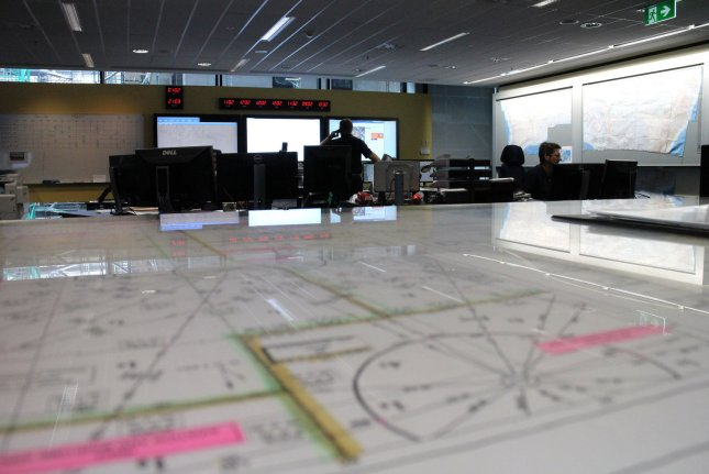 This photo released by the Australian Maritime Safety Authority on March 20, 2014 shows Search and Rescue Officers coordinating the search for missing Malaysia Airlines flight MH370 in their Rescue Coordination Centre in Canberra, Australia. UPI/Australian Maritime Safety Authority