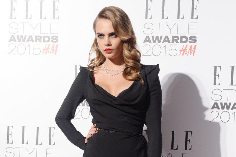 Cara Delevingne shows off plunging neckline at Elle Style