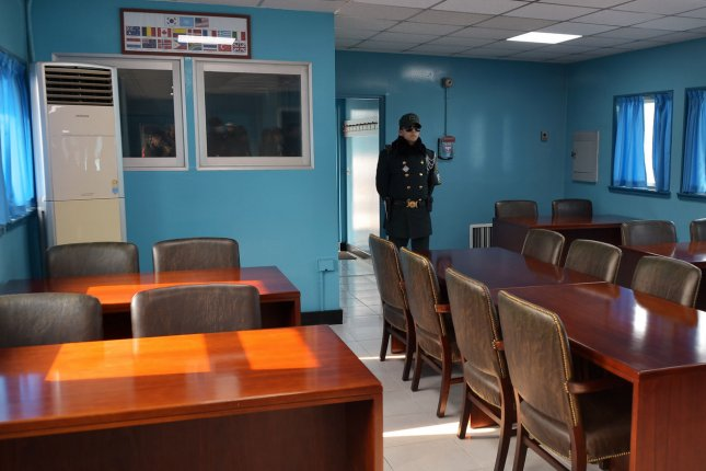A South Korean soldier stands guard in a conference room in the United Nations Command Military Armistice Commission Conference Building at the joint security area (JSA) of Panmunjom in the demilitarized zone (DMZ) in Paju, South Korea, on February 18. North Korea threatened to attack the South Korean president's residence Wednesday. Photo by Keizo Mori/UPI