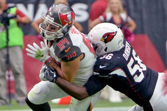 Tampa Bay Buccaneers tight end Cameron Brate (L) picks up yardage in the first quarter against the Arizona Cardinals on October 15, 2017 at University of Phoenix Stadium in Glendale, Arizona. Photo by Art Foxall/UPI