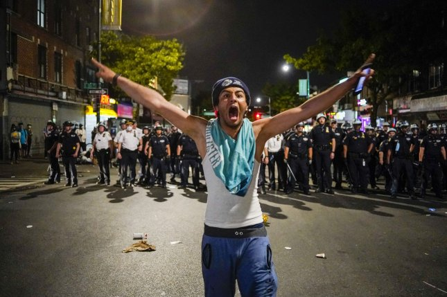 A protester yells at police when Black Lives Matter protesters clashed with New York Police Department officers as protests continue over the death of George Floyd at the hands of the Minneapolis police, in New York City on Saturday. Photo by Corey Sipkin/UPI