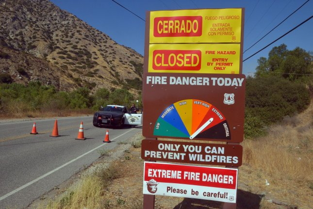 A sign on the Angeles Crest Highway warns the public about the extreme fire danger in the San Gabriel Mountains near Juniper Hills, Calif., on Monday. Photo by Jim Ruymen/UPI