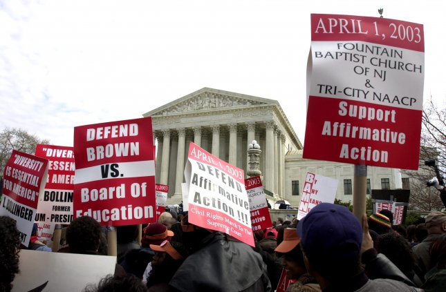 Thousands of pro-affirmative action protesters line the side walk in front of the Supreme Court in Washington on April 1, 2003, as the Court heard arguments in Grutter vs. Bollinger. The question was whether the University of Michigan Law School may legally use racial preferences in student admissions. -- Roger L. Wollenberg UPI