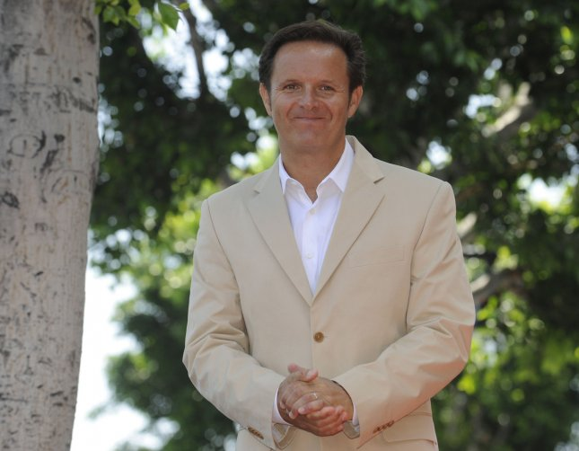 Producer Mark Burnett attends a ceremony where he receives a star on the Hollywood Walk of Fame in Los Angeles on July 8, 2009. Burnett has produced reality television series like Survivor, The Apprentice, The Contender, and Are You Smarter Than a Fifth Grader.(UPI Photo/ Phil McCarten)
