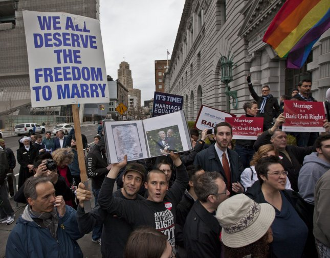 Supporters of gay marriage hold up a photo and copy of their marriage certificate at rally outside the Ninth Circuit Court of Appeals as judges rule that California's Proposition 8, a ban on same-sex marriages is unconstitutional, in San Francisco on February 7, 2012. UPI/Terry Schmitt