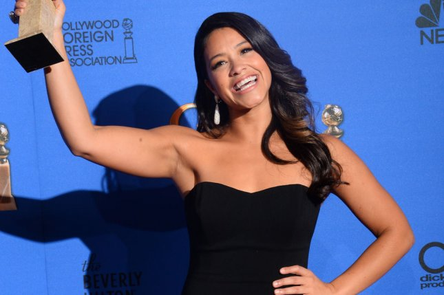 Gina Rodriguez appears backstage with the award she won for her role in Jane the Virgin during the 72nd annual Golden Globe Awards in Beverly Hills on January 11, 2015. File Photo by Jim Ruymen/UPI