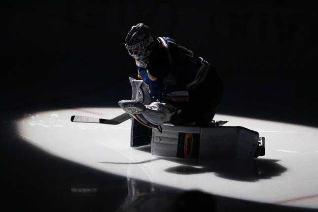 St. Louis Blues goaltender Jake Allen stretches before a game against the Winnipeg Jets at the Scottrade Center in St. Louis on January 31, 2017. Photo by Bill Greenblatt/UPI