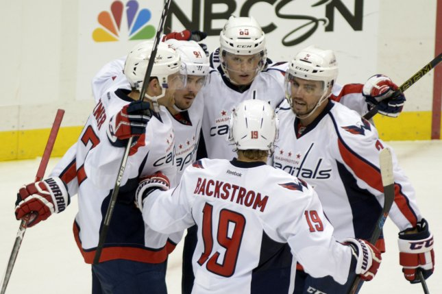 Nicklas Backstrom scored a power-play goal with 1:35 left in overtime and the Washington Capitals defeated the Philadelphia Flyers 2-1 on Saturday night, extending their franchise-record home winning streak to 15 games. File Photo by Archie Carpenter/UPI