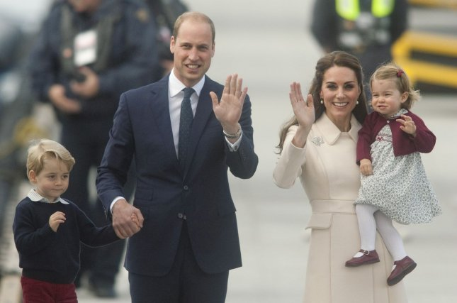 Prince William (2nd L) with wife Kate Middleton (2nd R), son Prince George (L) and daughter Princess Charlotte visit Victoria, British Columbia, on October 1. The British royal said in the July issue of British GQ that he wishes late mom Princess Diana had lived to know his family. File Photo by Heinz Ruckemann/UPI