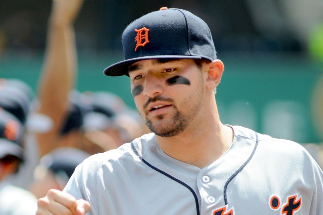 Detroit Tigers third baseman Nick Castellanos (9) greets his teammates before the start of a game. File photo by Archie Carpenter/UPI