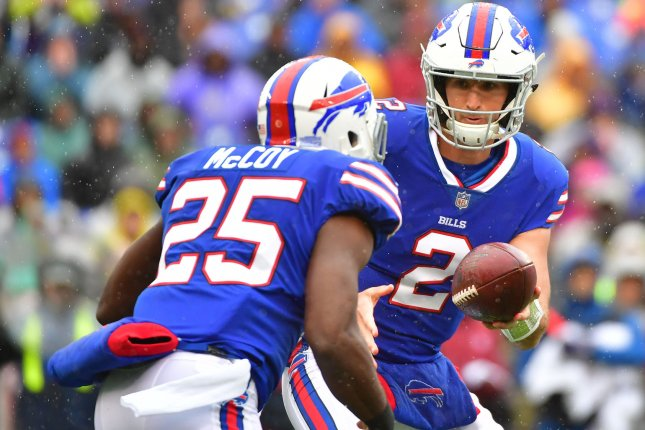 Buffalo Bills quarterback Nathan Peterman (2) hands off to running back LeSean McCoy (25) in the second quarter on Sunday at M&T Bank Stadium in Baltimore. Photo by Kevin Dietsch/UPI