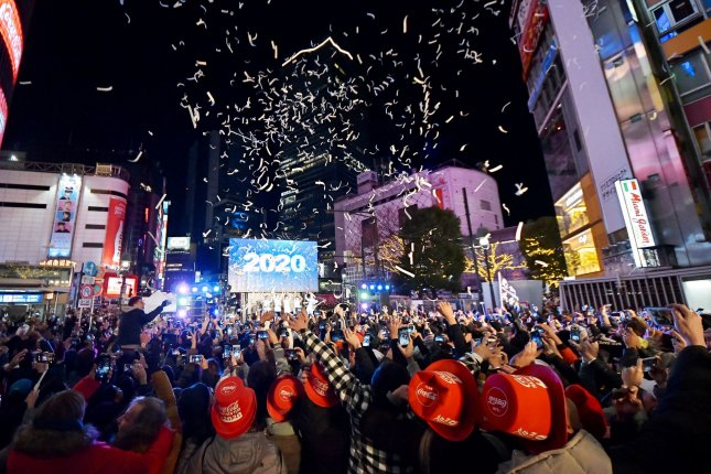 Hundreds celebrate the new year at the Shibuya district shopping street in Tokyo, Japan, on January 1. Photo by Keizo Mori/UPI