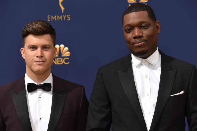 Michael Che (R) and Colin Jost attend the 70th annual Primetime Emmy Award on September 2018. Che is set to star in a sketch comedy series on HBO Max. File Photo by Christine Chew/UPI
