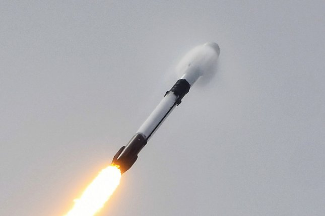 A SpaceX Falcon 9 rocket creates a vapor cone as it reaches supersonic speed during a launch of multiple satellites from Cape Canaveral Space Force Station in Florida on June 30. Photo by Joe Marino/UPI