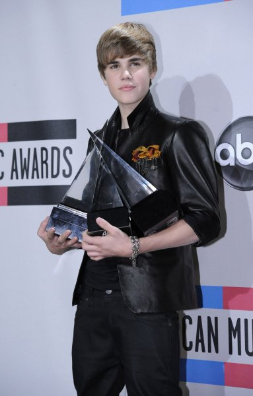 Singer Justin Bieber poses backstage at the 2010 American Music Awards held in Los Angeles on November 21, 2010. UPI/Phil McCarten