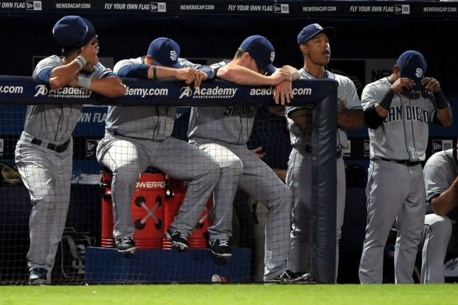 San Diego Padres coaches and players react late in the eighth inning in their game against the Atlanta Braves at Turner Field in Atlanta, September 14, 2013. Atlanta won 2-1, marking their first victory against the Padres this season. UPI/David Tulis