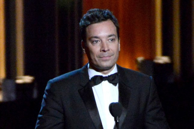 Jimmy Fallon speaks onstage during the Primetime Emmy Awards on August 25, 2014. Fallon and Barry Gibb performed a skit on The Tonight Show where they both sang a fall-inspired song as Barry Gibb. File Photo by Pat Benic/UPI