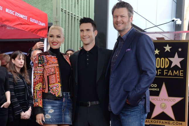 Gwen Stefani, Adam Levine and Blake Shelton (L-R) attend Levine's Hollywood Walk of Fame ceremony on February 10. Stefani shared posts Sunday from an outing with Shelton and two of her sons. File Photo by Jim Ruymen/UPI