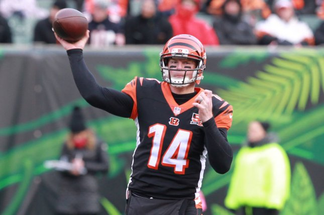 Cincinnati Bengals quarterback Andy Dalton (14) throws under pressure from the Chicago Bears' defense during the second half of play at Paul Brown Stadium in Cincinnati, Ohio, December 10, 2017. File photo by John Sommers II /UPI