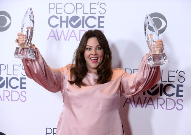 Actress Melissa McCarthy appears backstage with her award for Favorite Comedic Movie Actress and Favorite Comedic TV Actress during the 42nd annual People's Choice Awards in January. She and Ghostbusters costar Kristen Wiig performed a particularly bad version of the new movie's theme song on The Graham Norton Show. File Photo by Jim Ruymen/UPI