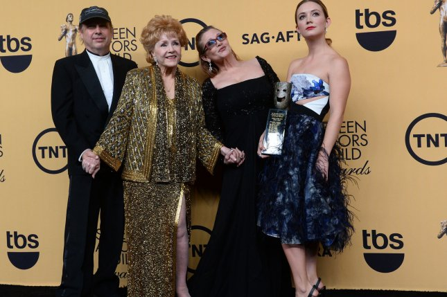 (L-R) Todd Fisher, actress Debbie Reynolds, actress Carrie Fisher and Billie Lourd pose backstage at the 21st annual SAG Awards in Los Angeles on January 25, 2015. Lourd has been named the sole beneficiary of her mother Carrie Fisher's estate. File Photo by Jim Ruymen/UPI