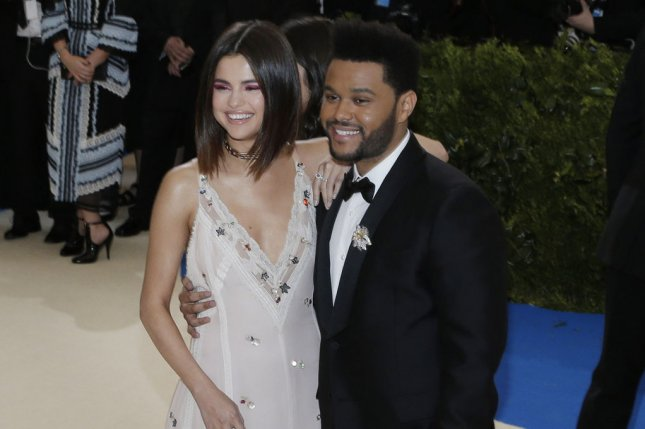 Selena Gomez (L) and The Weeknd attend the Costume Institute Benefit at the Metropolitan Museum of Art on May 1. Gomez opened up in the September issue of InStyle about her great relationship with The Weeknd. File Photo by John Angelillo/UPI