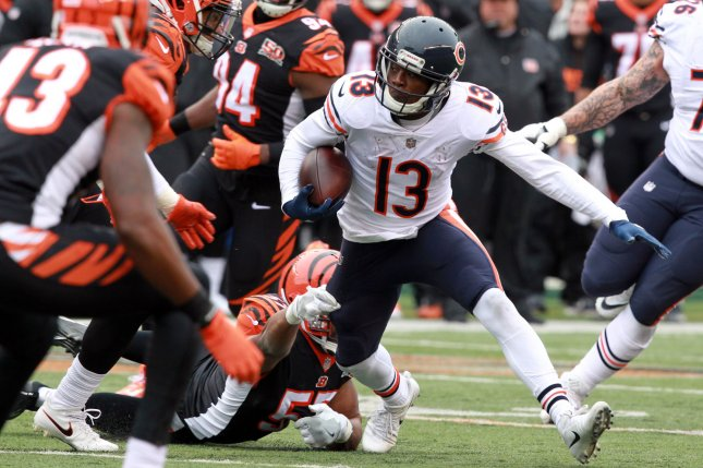 Chicago Bears wide receiver Kendall Wright (13) fights to break free from Cincinnati Bengals' Vontaze Burfict (55) during the first half of play on December 10 at Paul Brown Stadium in Cincinnati, Ohio. Photo by John Sommers II /UPI