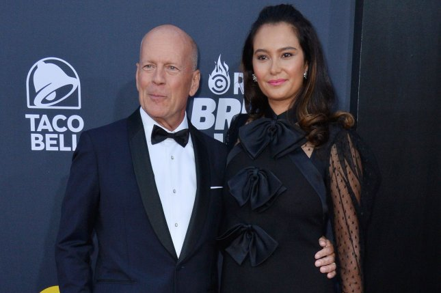 Bruce Willis (L) and his wife Emma Heming. File Photo by Jim Ruymen/UPI