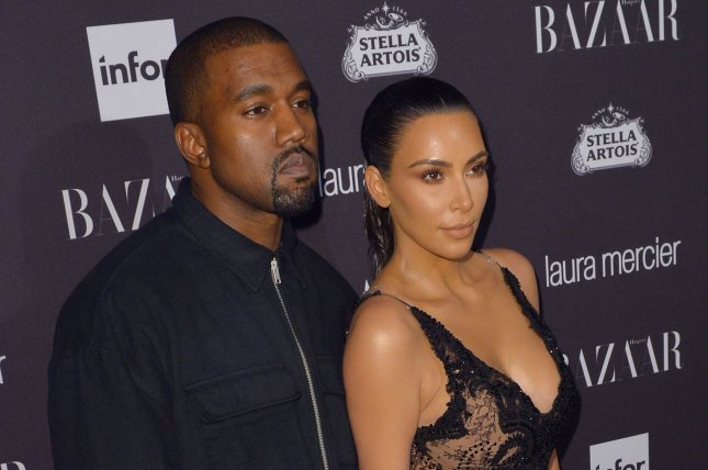 Kanye West (R) and Kim Kardashian. West apologized on social media for using his phone during a performance of The Cher Show. File Photo by Andrea Hanks/UPI