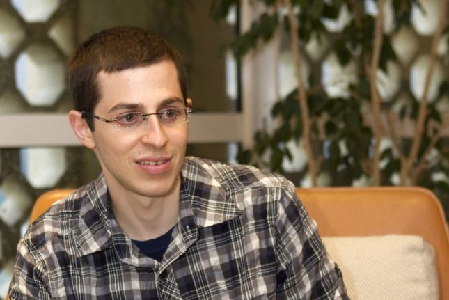 Israeli soldier Gilad Shalit speaks with France's ambassador to Israel Christophe Bigot (unseen) at the French Embassy in the Mediterranean city of Tel Aviv on January 11, 2012. On June 25, 2006, Shalit was kidnapped by militants from the Gaza Strip. He was released Oct. 18, 2011. File Photo by Jack Guez/UPI