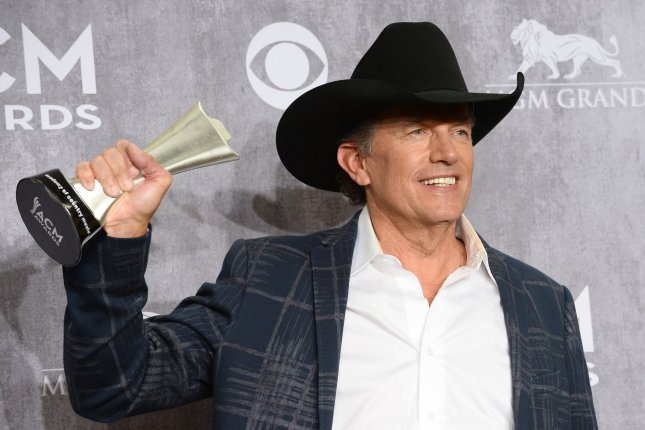 George Strait with his award at the Academy of Country Music Awards on April 6, 2014. The singer released new single 'Cold Beer Conversation' on Wednesday. File photo by Jim Ruymen/UPI