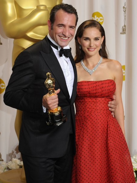 Best Actor Jean Dujardin for the movie The Artist appears with presenter Natalie Portman backstage at the 84th Academy Awards at the Hollywood and Highlands Center in Los Angeles on February 26, 2012. UPI/Jim Ruymen