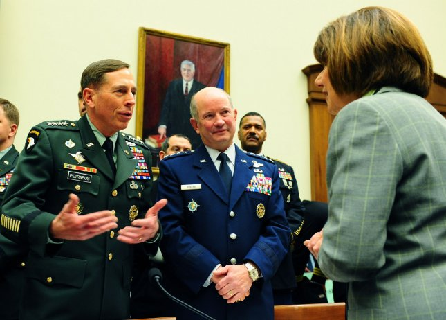 U.S. Army Gen. David Petraeus, Commander, U.S. Central Command (L), and U.S. Air Force Gen. Duncan McNabb, Commander, U.S. Transportation Command, chat with Members of Congress prior to testifying before the House Armed Services Committee on the Fiscal Year 2011 budget on Capitol Hill in Washington on March 17, 2010. UPI/Roger L. Wollenberg
