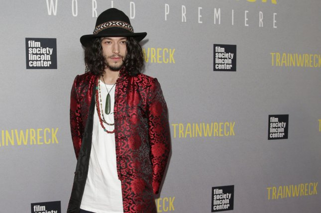 The Flash star Ezra Miller arrives on the red carpet at the New York premiere of Trainwreck on July 14, 2015. File Photo by John Angelillo/UPI