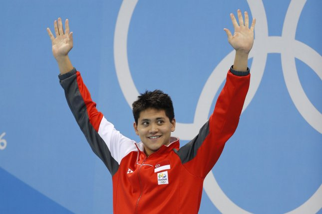 Joseph Schooling (SIN) reacts on the medal stand after his Men's 100M Butterfly gold medal time of 50.39 in the Olympic Aquatics Stadium on August 12, 2016. Singapore leads all countries in money awarded for gold medal winners. Photo by Matthew Healey/UPI